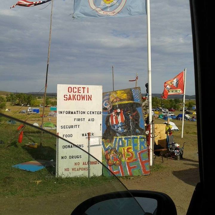 a photograph of the welcome sign at the Oceti Sakowin camp